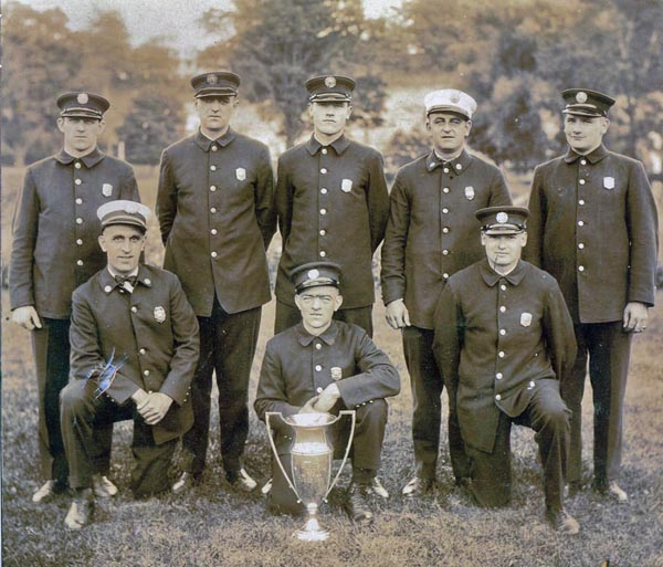 "Westchester County Volunteer Firemans Association 1929 Tug of War Champions, Mount Kisco FD ""Rummies"" In picture standing L-R, Ed Sehmlter, Art Gladwell, Art Fox, Ron Lowden, Frank Fox, seated, Martin Marshall, Ed Daly, Bill Bancroft"